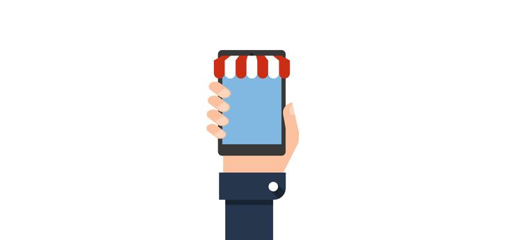 יד מחזיקה חנות וירטואלית בסמרטפון